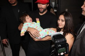 Brody Jenner stops to pose with an infant fan while walking to Ghostbar inside Palms Casino Resort.