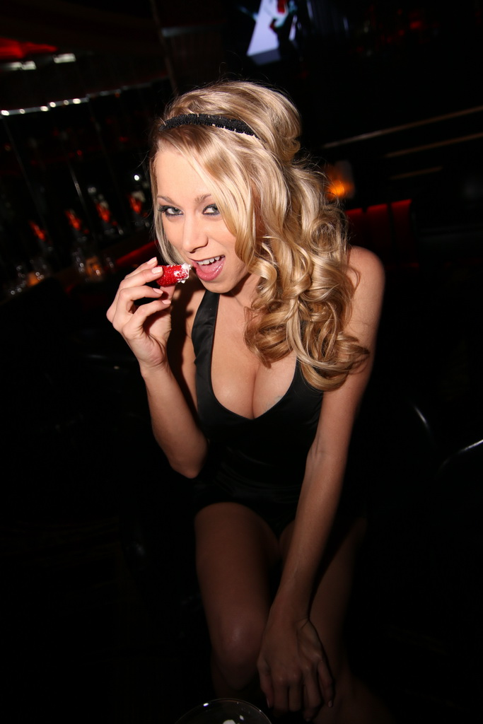 Katie Morgan Enjoying a Strawberry