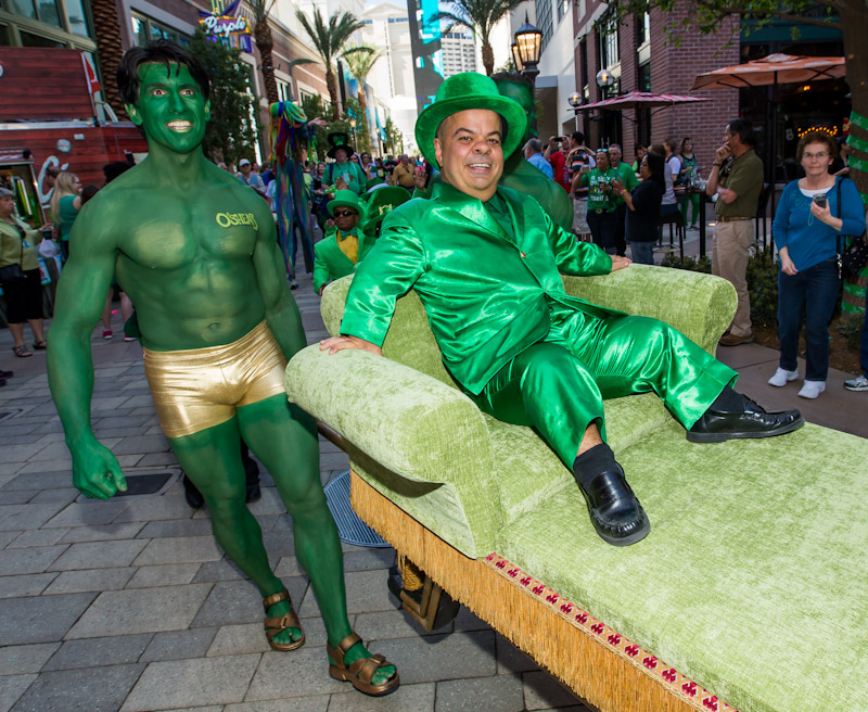 "Brian ""Lucky"" Thomas is carried through The LINQ by muscular green men as the group kicks off O'Sheas St. Patty's Day Block Party."