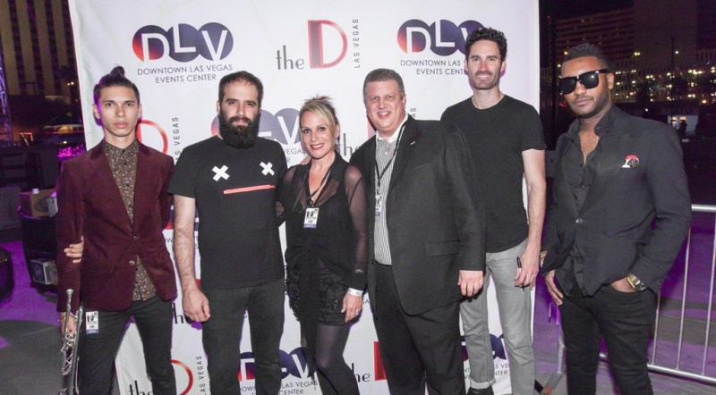 Capital Cities band members, including Sebu Simonian and Ryan Merchant pose with DLV owner Derek Stevens and Nicole Parthum before taking the stage