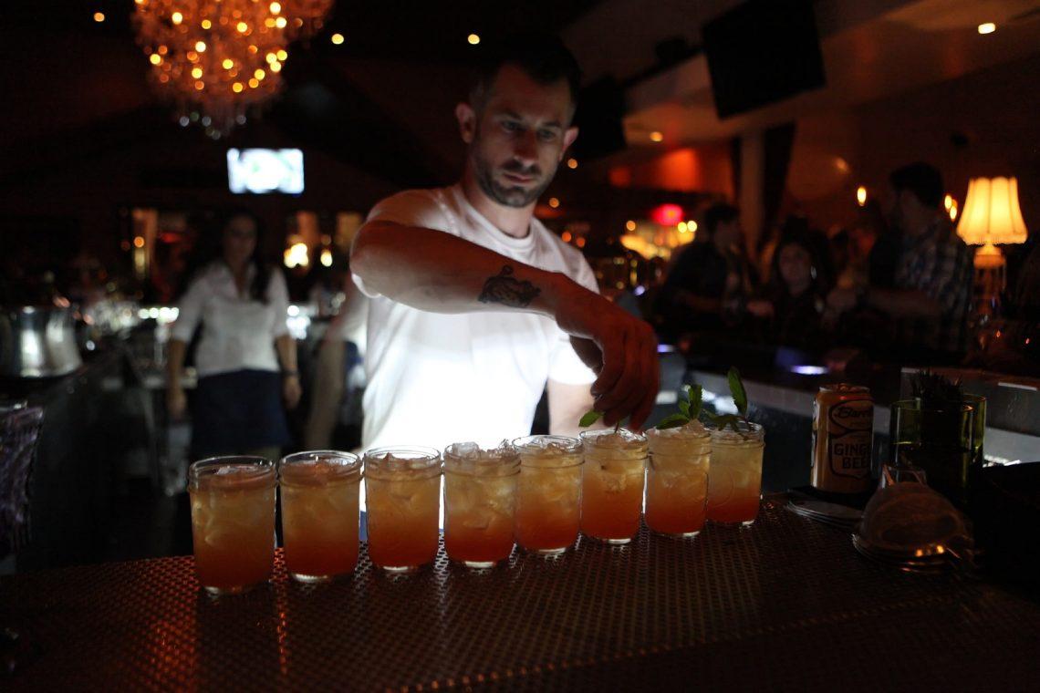 Bartender Serving Whist's Signature Cocktails