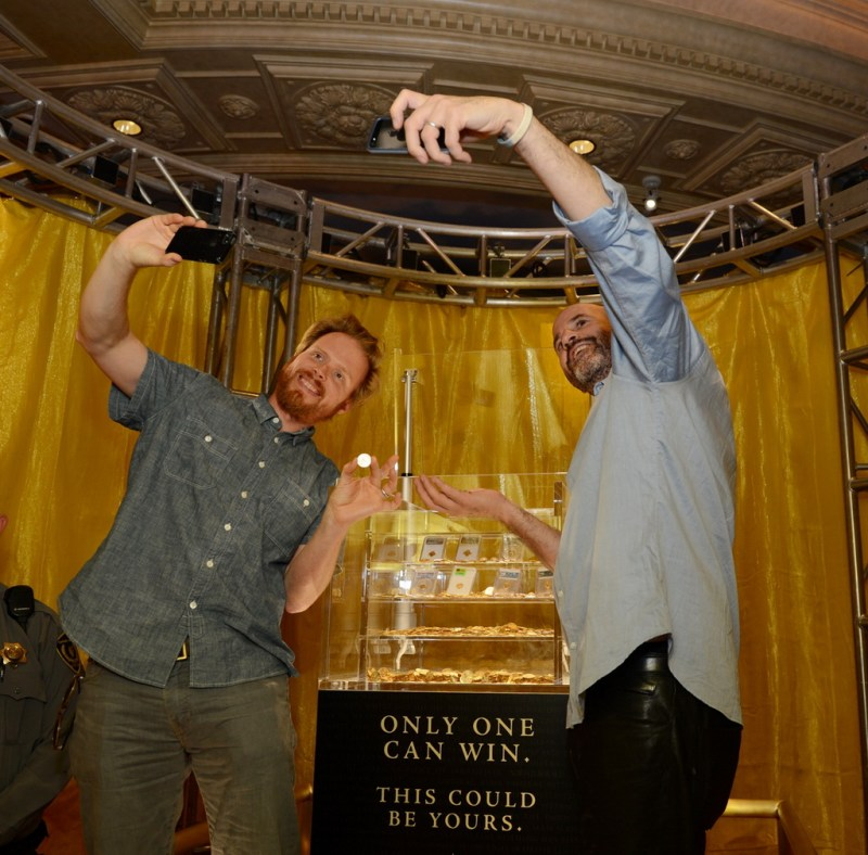 ENDGAME: The Calling co-Authors James Frey and Nils Johnson-Shelton enjoy posing with the $500,000 grand prize being displayed at Caesars Palace.
