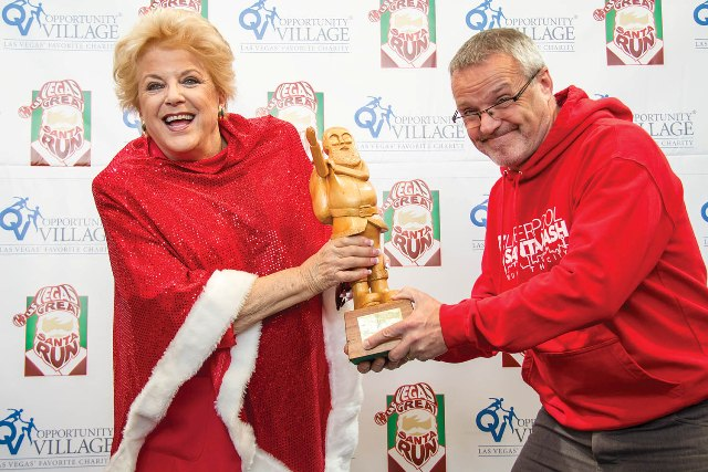 Mayor Carolyn Goodman and  Liverpool's Santa Dash's Alan Rothwell Fight for the World Santa Challenge  Trophy
