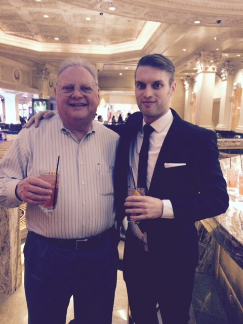 "Jay Sarno Jr. and son Ray toast with ""Sarno"" cocktail at Apostrophe Bar in Caesars Palace."