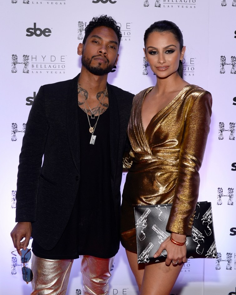 Miguel and girlfriend Nazanin Mandi pose on the red carpet at Hyde Bellagio, Las Vegas 12.31.14