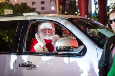 Santa Arrives in an Escalade to Holiday at The Park