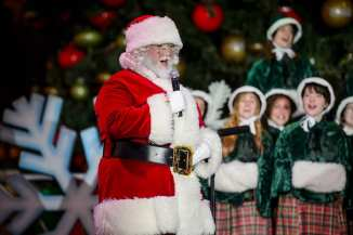 Santa Claus welcomes guests to Holiday at The Park
