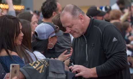 Coach Gallant Signs VGK Gear While Greeting Fans on the Red Carpet