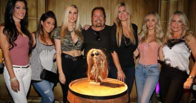 Vince Neil poses with girlfriend Rain Hannah and friends at The Golden Tiki