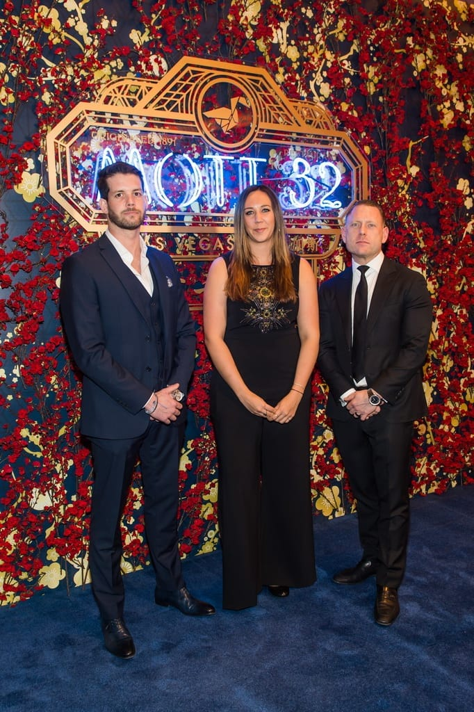Mott 32 General Manager Nathan Grates, Group F&B Director Katelyn Ix and Senior Group Director of Operations Michael Main walk the carpet at Mott 32's grand opening_credit Brenton Ho