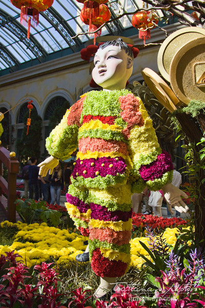 Chinese kid made out of fresh cut flowers