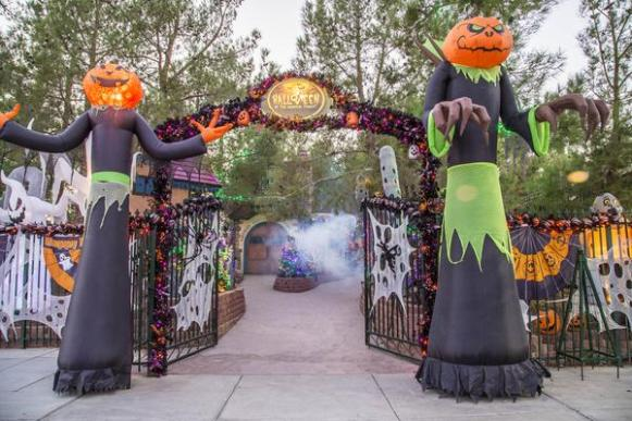 Entrance to Opportunity Village Halloveen, with two large scary pumpkin heads on either side