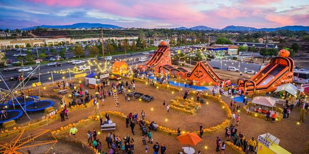 Aerial shot of Pumpkin Patches, with rides, inflatables and pumpkins