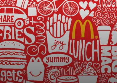 McDonalds logo with red and white grafitti type words and drawings