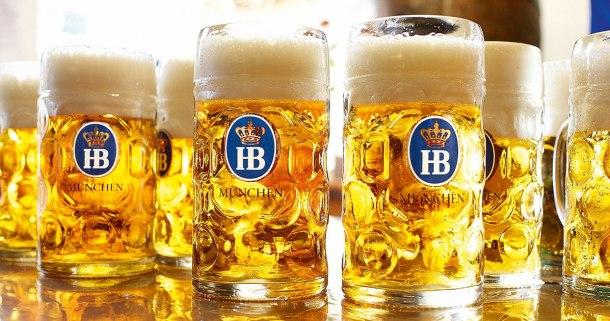 Hofbrauhaus beer steins filled with golden beer