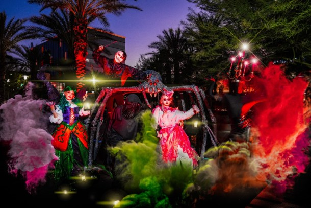 Scary costumes, colored smoke, for parade of Mischief in downtown Summerlin