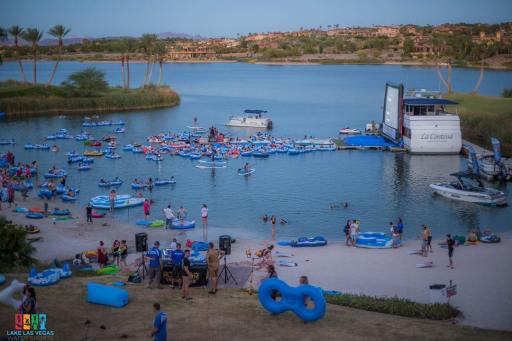 Jaws on the Water event on large screen at Lake Las Vegas, people and rafts