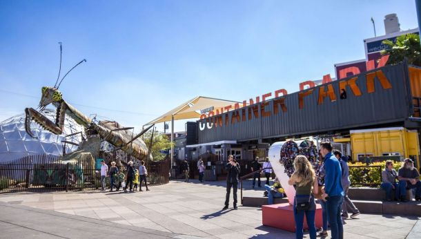 front of Downtown Container Park sign with grasshopper and dome