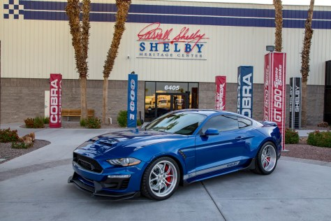 Blue Shelby Mustang in front of the Shelby Heritage Museum