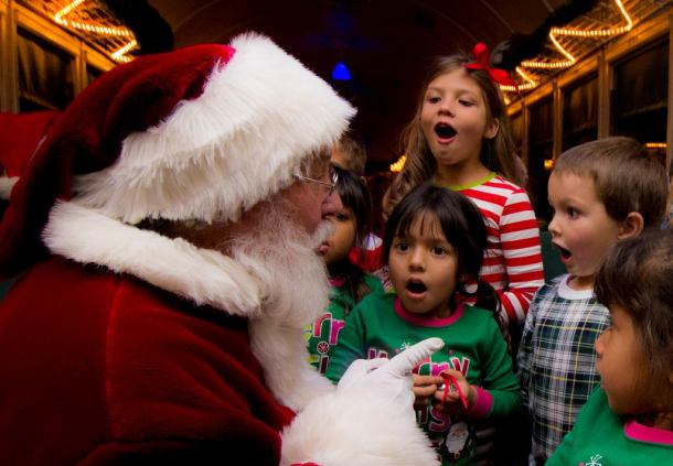 Santa Claus on Train talking to a group of kids