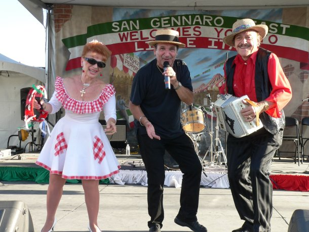 Old world performers, woman and two men at San Gennaro Feast