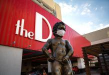 Manneken Pis Statue at the D Las Vegas Masks up for Nevada