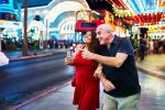 Mature,Couple,Sightseeing,In,Downtown,Las,Vegas,Streets