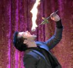 Kyle Knight eats fire during the Grand Illusion round of Syfy's Wizard Wars