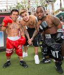 Justin Bieber with mini-Pacquiao and mini-Mayweather