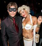 Crispin Glover (in the mask) at the party with a guest (The Empress)