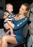 Holly Madison with a baby at SuperZoo 2012 Convention at Mandalay Bay