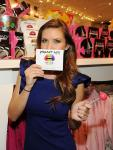 Audrina Patridge playing around with a set of temporary candy lip tattoos at the grand opening of Sugar Factory at MGM Grand