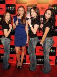 Audrina Patridge poses with Sugar Factory's signature bedazzled jean models at the grand opening of Sugar Factory at MGM Grand
