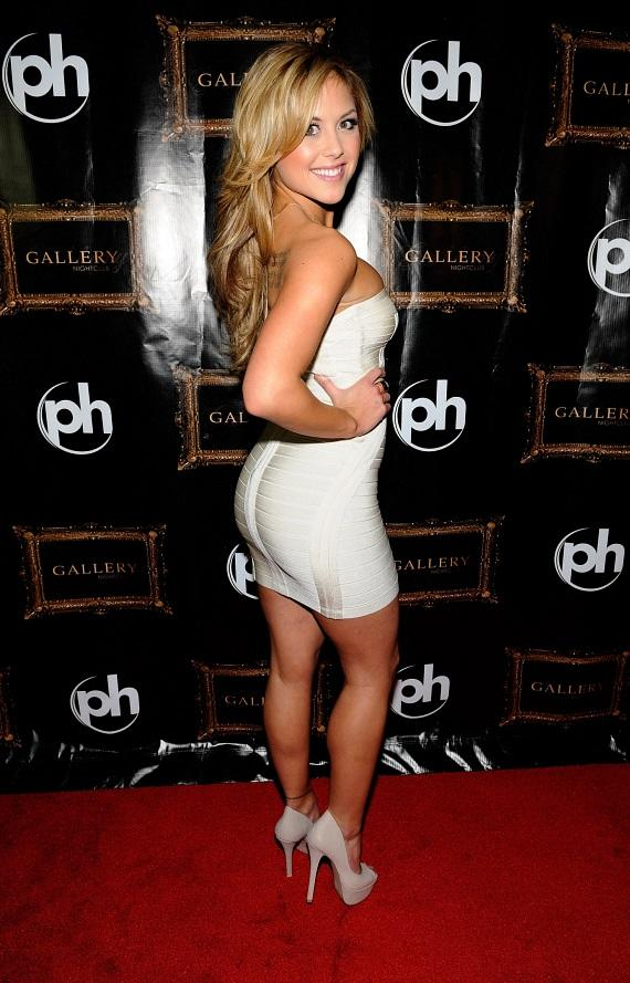 Brittney Palmer poses with Sugar Factory Signature Couture Pop on Gallery Nightclub Red Carpet