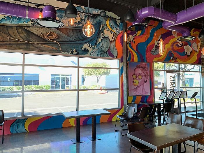 SkinnyFATS Celebrates 7-Year Anniversary By Reopening For Dine In With New Interior Floors & Murals