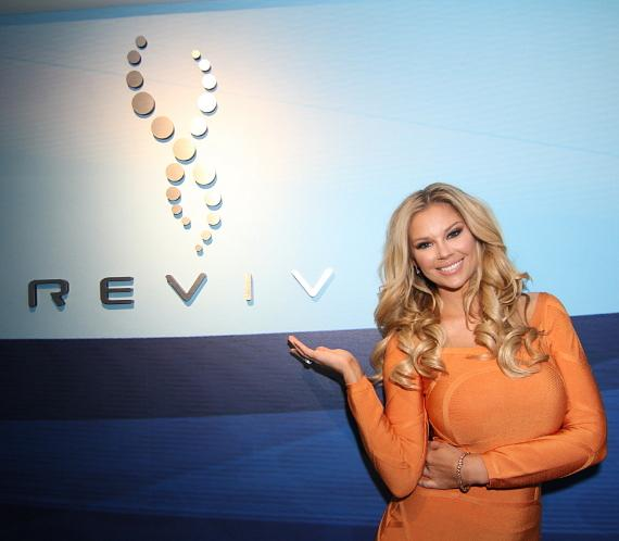 Jessa Hinton relaxes in the REVIV 'Living Room'