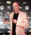 "Jon Taffer with his newest book ""Raise the Bar"""
