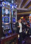 David Copperfield poses with his Bally Technologies slot machine The Magic of David Copperfield at MGM Grand after its unveiling on June 26, 2014