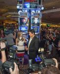 David Copperfield speaks with a reporter immediately following the unveiling of his new Bally Technologies slot machine at MGM Grand
