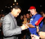 Michael Ealy autograhing for fans at red carpet
