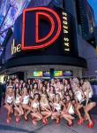 Miss D Legs Contestants pose under the D Banner on Fremont Street in Las Vegas