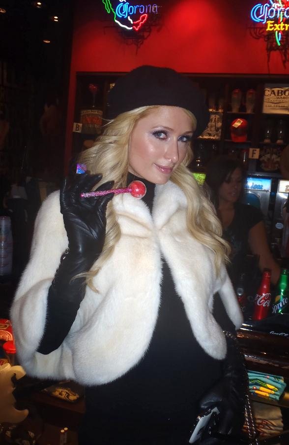 Paris Hilton pictured today at Cabo Wabo Cantina in Las Vegas with her new Sugar Factory Champagne Stick Couture Pop