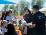 Volunteers including Maurice Wooden, president of Wynn Las Vegas, pass out cookies at Petersen Elementary School's Spook-tacular Fall Festival, Saturday, Oct. 20