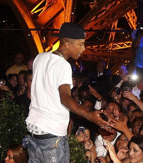 Pharrell talking to the crowd at Chateau Gardens grand opening