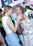 Whitney Port (L) embraces with sister Jade during bottle service
