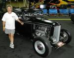 """Nick Kallos with """"Blackie"""", a 1932 Ford 3-Window Coupe at Barrett-Jackson"""