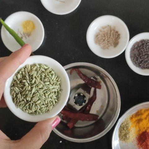 adding whole spices to jar