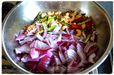 Adding chopped onions to the tempered ingredients