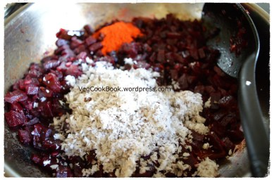 Adding grated coconut and red chilli powder