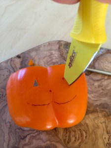 Carving an orange bell pepper